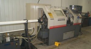 Cincinnati Milacron lathe with bar feeder at Roberts Machine Products, West Liberty, Ohio